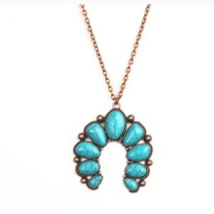 Turquoise lucky stone necklace.